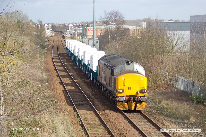 190314-006  Direct Rail Services class 37 No. 37423 Spirit of the Lakes captured passing Tenter Lane, Mansfield, powering train 6Z37, 12:06 Shirebrook, WH Davis - Crewe Coal Sidings. In tow are eight new nuclear flask wagons, type FNA, the last of a order for 24 of these.