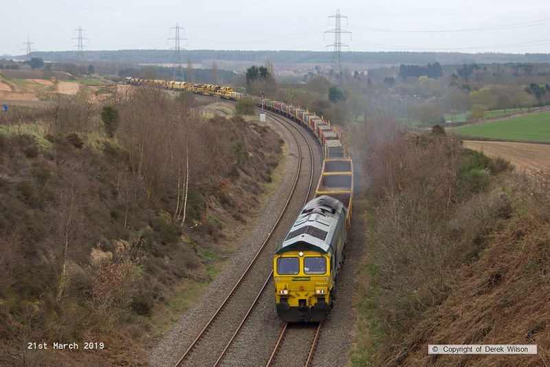 190321-005  Freightliner class 66/5 No. 66525 is captured heading towards Welbeck Junction, leading 6X04, 16:00 Thoresby Colliery Junction - Doncaster, Belmont Down Yard. In tow is track renewal system four (TRS4) with 66515 bringing up the rear. The renewal train had spent the last three weeks on the High Marnham Test Track.