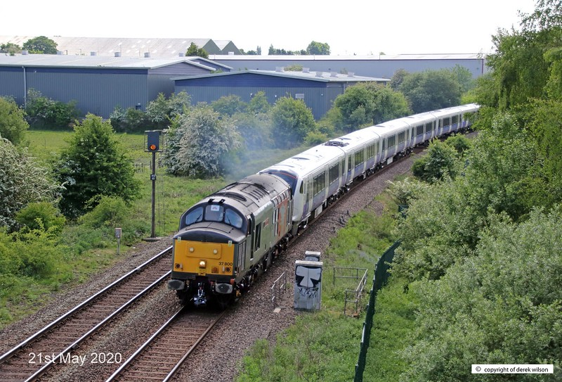 200521-010  Rail Operations Group class 37 No. 37800 Cassiopeia is seen passing the A617 bypass at Sutton-in-Ashfield, on the Robin Hood Line. In tow is a class 345 unit, train 5Q26, 10:21 Old Dalby - Worksop Down Yard.