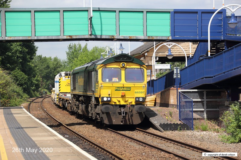 200526-005  Freightliner class 66/5 No. 66597 Viridor is seen 'off route' sauntering through Mansfield Woodhouse powering train 6M73, 10:50 Doncaster up Decoy - Toton North Yard. In tow is KFA wagon 9305 and Kirow crane DRK 81625. .
