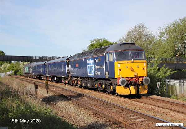 200515-003  Rail Operations Group class 47 No. 47813 Jack Frost and class 57 No. 57301 Goliath are seen 'top and tail' a pair of barrier vehicles. The ensemble was captured passing the closed foot crossing at King's Mill on the Robin Hood Line. Train 5E26, 07:10 Leicester L.I.P - Worksop Down Yard.