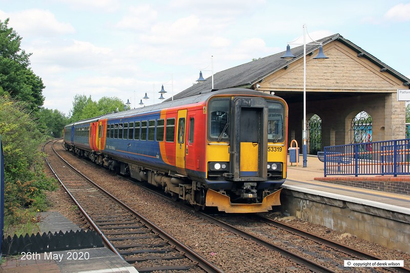 200526-001  East Midlands Railways class 153 unit No, 153319 and class 156 No. 156411 are captured at Mansfield Woodhouse with 2D12, the 12:38 Worksop - Nottingham.