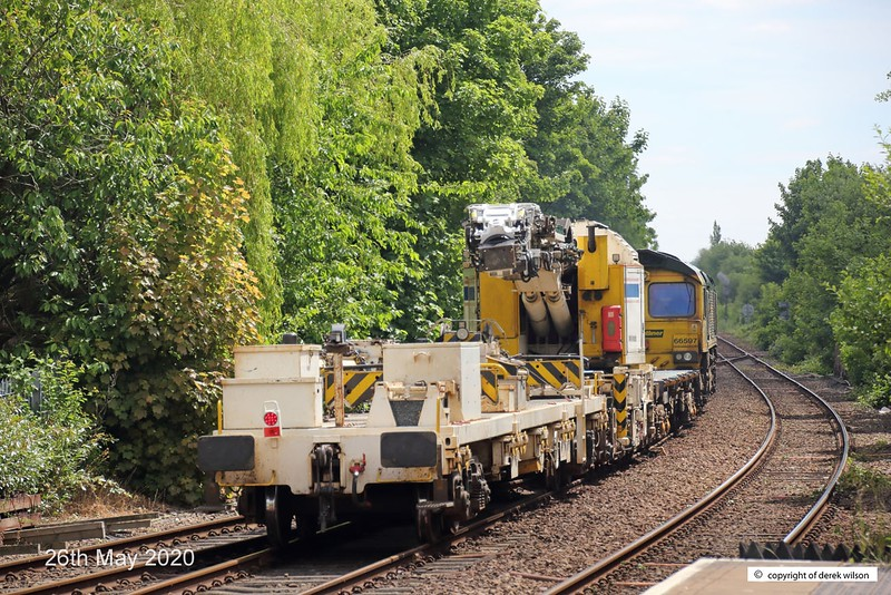 200526-011  Freightliner class 66/5 No. 66597 Viridor is seen 'off route' sauntering through Mansfield Woodhouse powering train 6M73, 10:50 Doncaster up Decoy - Toton North Yard. In tow is KFA wagon 9305 and Kirow crane DRK 81625.