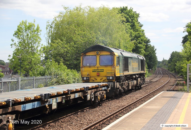 200526-009  Freightliner class 66/5 No. 66597 Viridor is seen 'off route' sauntering through Mansfield Woodhouse powering train 6M73, 10:50 Doncaster up Decoy - Toton North Yard. In tow is KFA wagon 9305 and Kirow crane DRK 81625.
