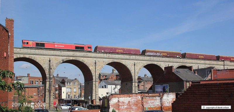 200520-005  DB Cargo class 66/0 No. 66097 is captured crossing Mansfield's 15 arch viaduct, powering train 6V70, 09:58 Worksop up Reception - Cardiff Tidal T.C. In tow are a rake of redundant HTA coal hoppers for cutting up. Coal trains were common place as Mansfield was in the heart of the Nottinghamshire coal fields, but sadly, this could well be the last time that a full rake of coal hoppers will traverse the viaduct, although some have, and still are being converted for use in the aggregates sector.