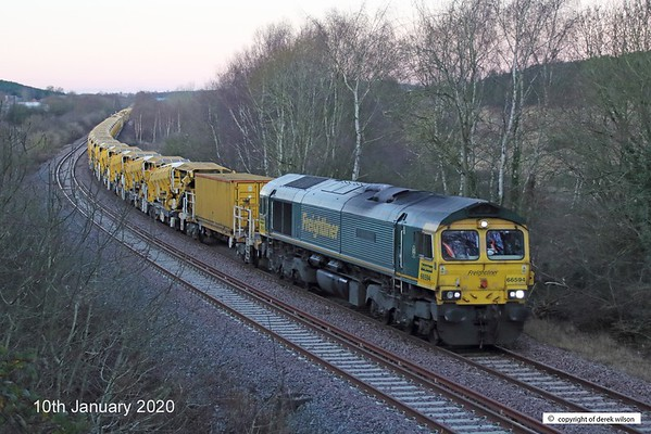 200110-004  Freightliner class 66/5 No. 66594 NYK Spirit of Kyoto is captured passing Ollerton, on the High Marnham Test Track, with a High Output Ballast Cleaner in tow, Classmate 66551 is well out of sight at the rear of the ensemble. Train 6Y37, 01:53 Tyne S.S. - High Marnham.