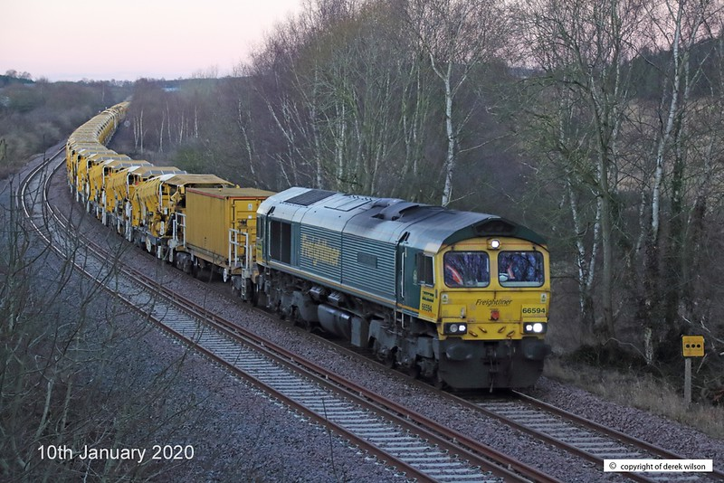 200110-002  Freightliner class 66/5 No. 66594 NYK Spirit of Kyoto is captured passing Ollerton, on the High Marnham Test Track, with a High Output Ballast Cleaner in tow, Classmate 66551 is well out of sight at the rear of the ensemble. Train 6Y37, 01:53 Tyne S.S. - High Marnham.
