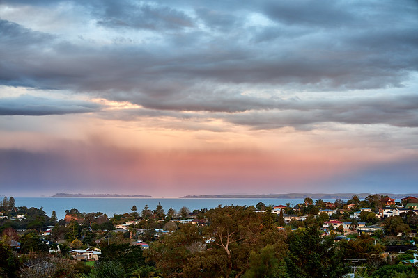 Torbay on Auckland's North Shore as a weather system passes over the Hauraki Gulf at dusk