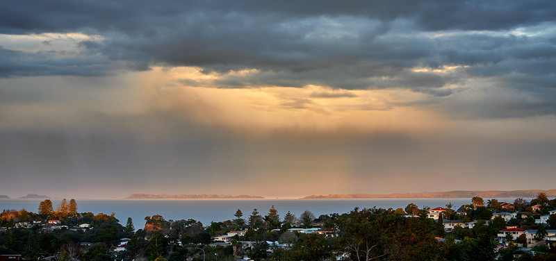 Torbay on Auckland's North Shore as a weather system passes over the Hauraki Gulf