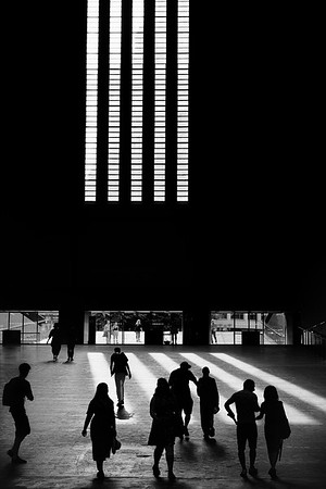 Silhouettes inside the Tate Modern, London