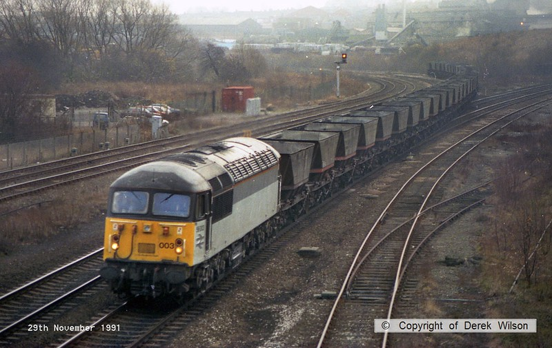911129-005     Romanian built class 56 no 56003 comes off the Erawash line, on to the down main at Clay Cross, powering a rake of emty coal hoppers.