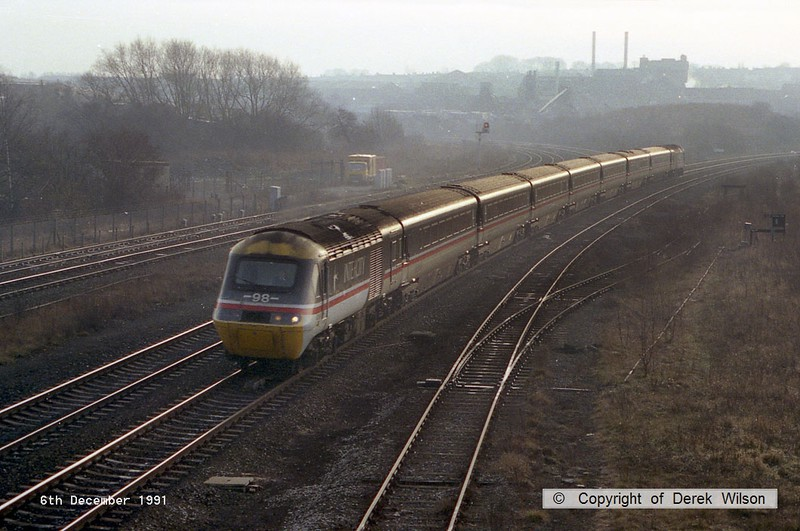 911206-001     A Intercity HST with power cars 43098 (leading) and 43104 (rear) speed through Clay Cross with a London St Pancras to Sheffield service.