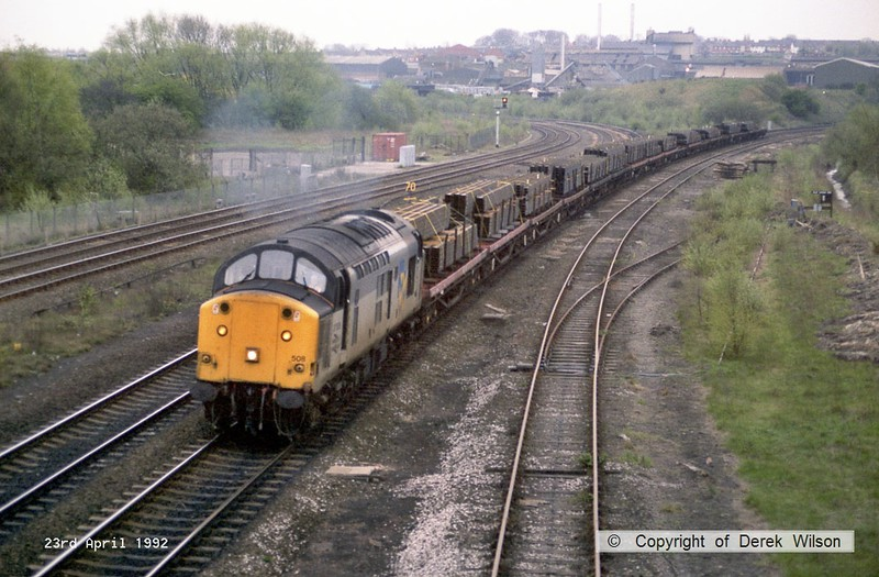 920423-001     Trainload Steel class 37 no 37508 on the down main at Clay Cross, powering a loaded steel train.