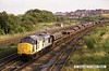 920715-006     BR class 37/7 no 37884 passing Clay Cross with a loaded steel train.