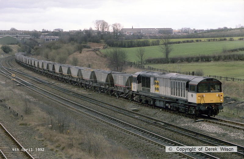 920404-001     Trainload Coal class 58 no 58045 is captured passing Clay Cross, heading along the passing loop with a rake of empty coal hoppers.