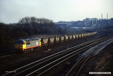 930326-005     BR class 56 no 56019 in Railfreight grey with red solebar stripe, seen leaving the Erawash line at Clay Cross, hauling a rake of empty coal hoppers. I didn't record the time but was the last sighting of the session, I left at 4.40 pm so would have been just before then.