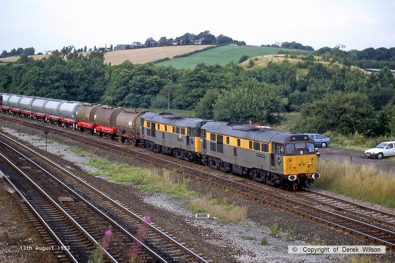 930813-004  A pair of 'Dutch' livery BR class 31's No's 31146 Brush Veteran & 31147 Floreat Salopia are seen at Clay Cross, on the up Erewash, hauling a rake of 4 wheel tanks.