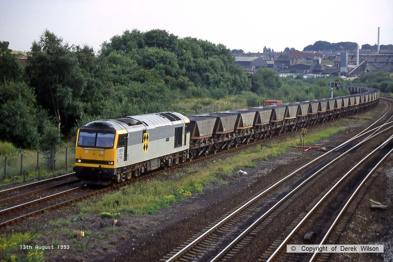 930813-003  BR class 60 No 60072 Cairn Toul is seen passing Clay Cross with a rake of loaded coal hoppers.