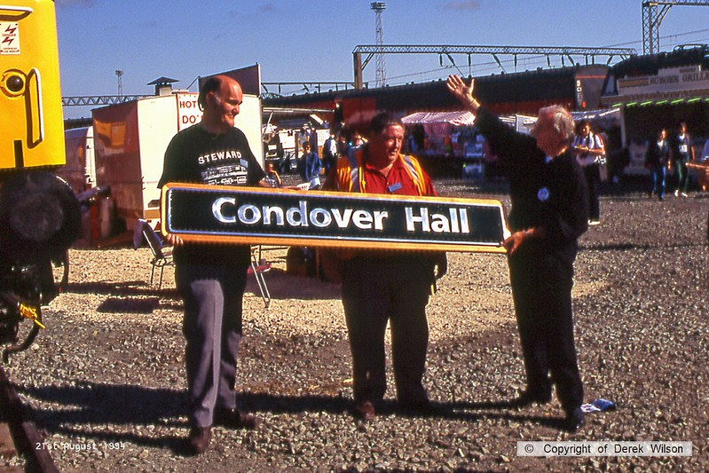 940821-010  Pete Waterman (right) & Co. with Condover Hall nameplate which was later unveiled on Railfreight Distribution class 47 No. 47784. Crewe Railfair.