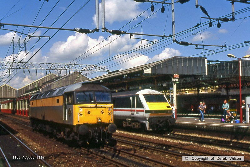 940821-062  'Dutch' livery class 47 No. 47300 is seen passing through Crewe station.