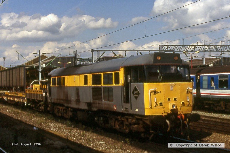 940821-065  Dutch livery class 31 No. 31242 is seen passing through Crewe with a engineers train.