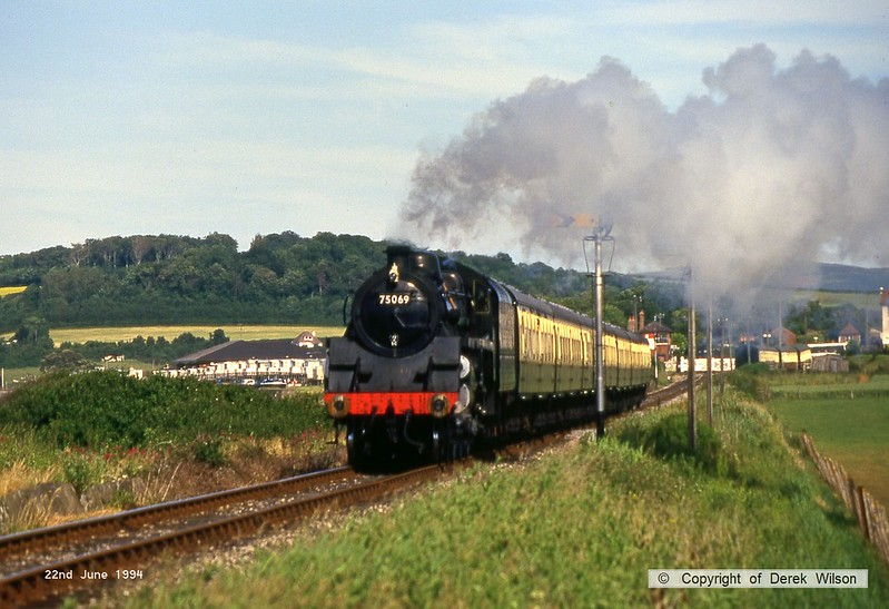 940622-002  BR 4MT 4-6-0 No 75069 is captured passing Blue Anchor Bay, West Somerset Railway.