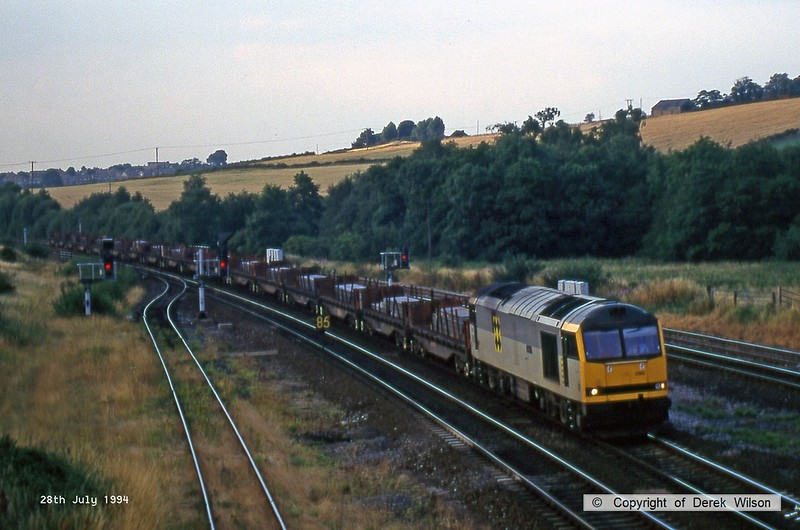 940728-007  Class 60 No. 60090 Quinag ia captured passing Clay Cross on the up main with a loaded steel train.
