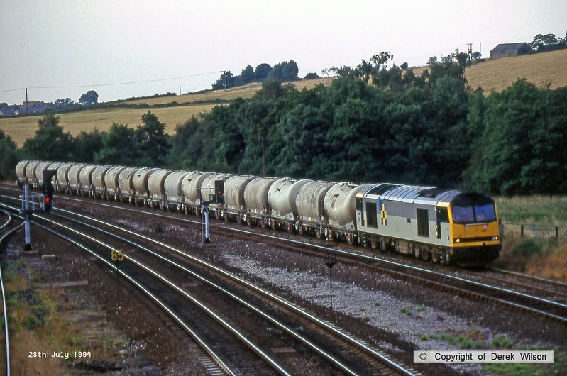 940728-006  Class 60 No. 60082 Mam Tor heads along the up Erewash at Clay Cross, hauling a rake of loaded cement tanks.