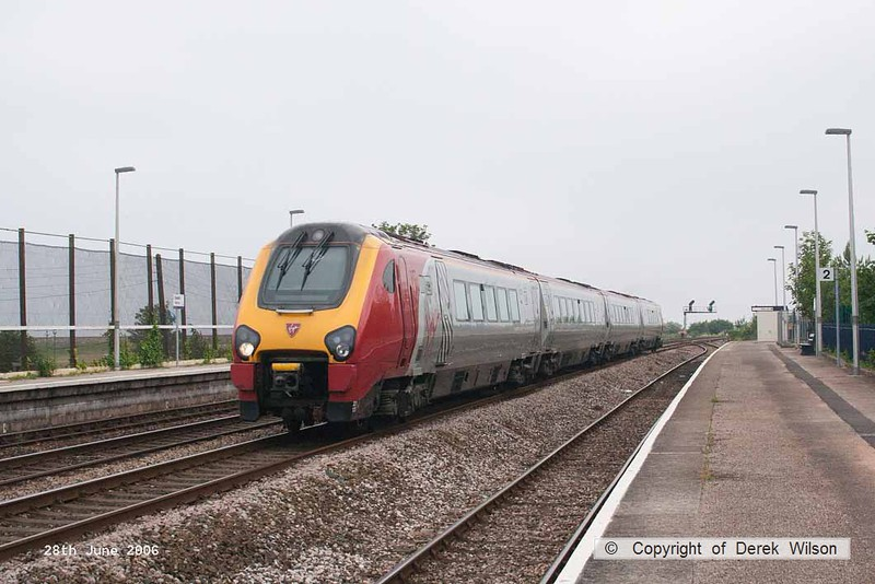 060628-004     Virgin Cross Country class 221, Super Voyager unit no 221125 speeds through Dawlish Warren with  the 17.25 Plymouth to Preston.