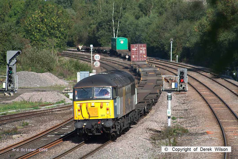 061003-004     Fastline Freight class 56 no 56301 is captured passing Clay Cross with very lightly loaded Intermodal 4O90, 11.01 Doncaster Railport to Thamesport.