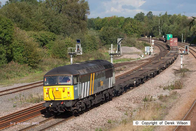 061003-006     Fastline Freight class 56 no 56301 is captured passing Clay Cross with very lightly loaded Intermodal 4O90, 11.01 Doncaster Railport to Thamesport.