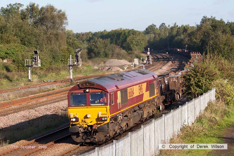 061007-006     EWS class 66/0 no 66064 heads south along the Erawash line at Clay Cross, powering a unidentified loaded steel train.
