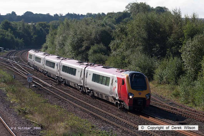 061003-002     Virgin Super Voyager, class 221 no 221124 speeds past Clay Cross with a northbound Cross Country service.