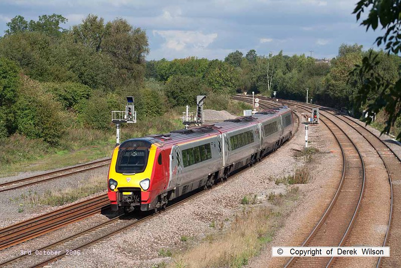 061003-003     Virgin Voyager unit, class 220 no 220025 speeds past Clay Cross with a southbound Cross Country service.