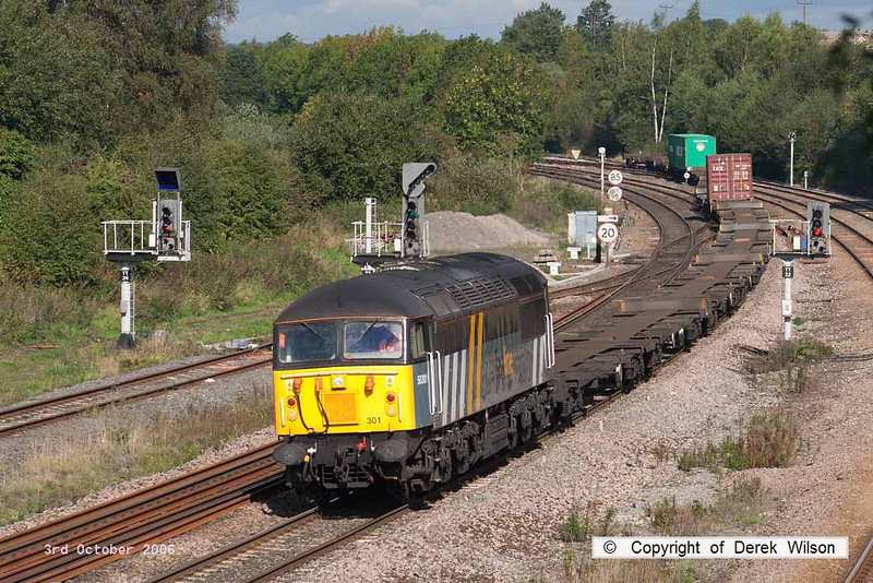061003-005     Fastline Freight class 56 no 56301 is captured passing Clay Cross with very lightly loaded Intermodal 4O90, 11.01 Doncaster Railport to Thamesport.
