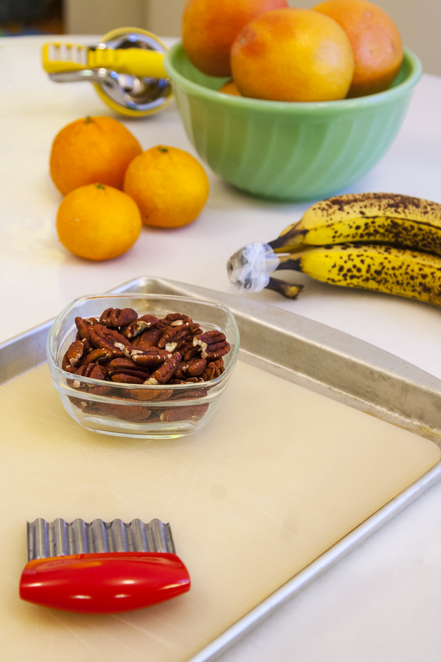 Raising a Foodie: Chopping Pecans on a Cutting Board Placed in a Sheet Pan