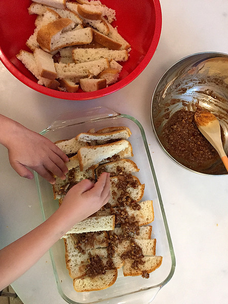Layer Bread Strips, Coating Each with Earth Balance, Maple Sugar, Cinnamon, and Nutmeg Mixture
