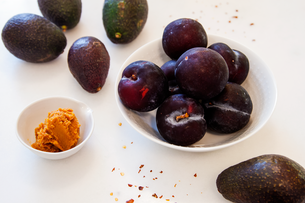 Black Plums from Farm Fresh to You, Haas Avocados, Crushed Red Chili Pepper, and Dashi add depth, tartness, zing, and creaminess to a summer meal.