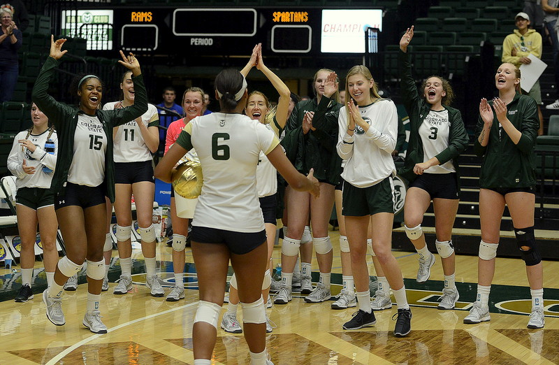 Jasmine Hanna is congratulated by her team as the senior became the all-time kills leader at Colorado State in a sweep of San Jose State on Thursday night at Moby Arena. Hanna led the team with 13 kills, giving her 1,074 total.