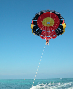 This image is model released. Woman parasailing at Punta Cana, Dominican Republic. © Rob Huntley