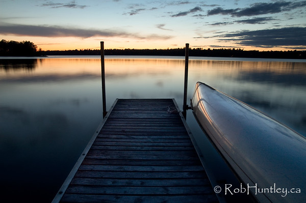 The dock at dusk. The islands we swam to (or around) are in the upper left corner. © Rob Huntley