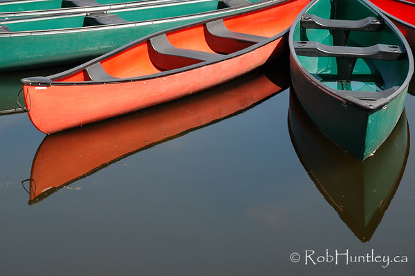 Rental canoes tied up at wharf at the pavilion on Dows Lake in central Ottawa, Ontario, Canada  © Rob Huntley