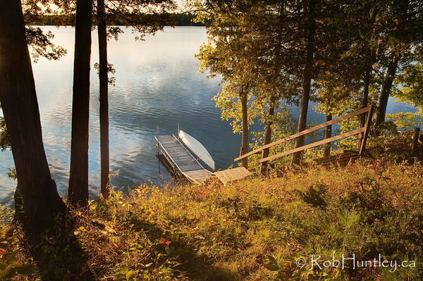 Dock and canoe. Better light later in the day than the first dock photo. © Rob Huntley