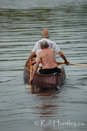 Friends canoeing on MacGregor Lake in Quebec.<br /> © Rob Huntley