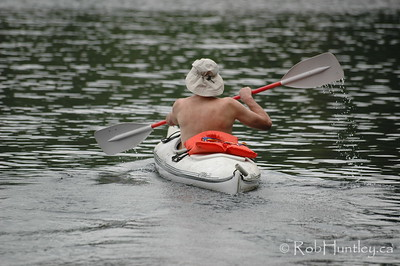Friend kayaking on MacGregor Lake in Quebec. © Rob Huntley