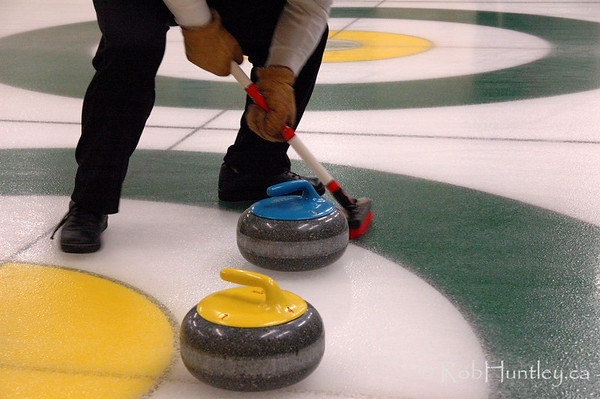 Curling action at the Granite Curling Club of West Ottawa. This session took place in a low light situation. High level of digital noise in these photographs make them ideally suited for web use or small prints. Therefore only low resolution downloads and small prints have been activated in the buy options.   © Rob Huntley