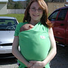 Here is Crystal carrying Michael. He got too heavy for her on the uphill part so Adam took him. <br /> She would have been fine carrying him downhill. The baby loved this contraption.