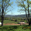 View toward the side yard. The barns and fields of the farm are visible and the Smokies.