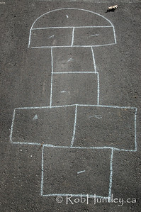 Hopscotch game outline drawn in chalk on driveway.  © Rob Huntley