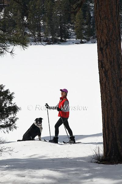 Model Released, Female Snowshoer, Marilyn Leftwich with her Dog, Rafiki, Haviland Lake, San Juan National Forest, Durango, Colorado, USA, North America